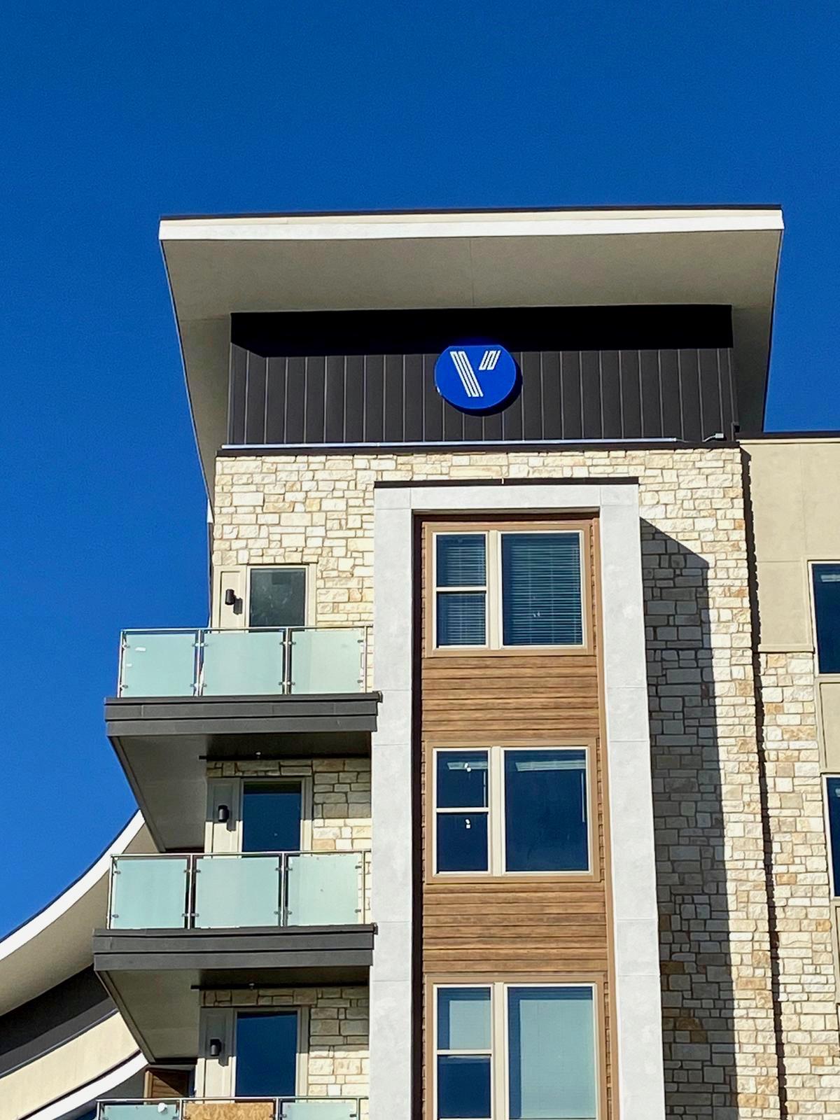 Vitruvian Building Sign